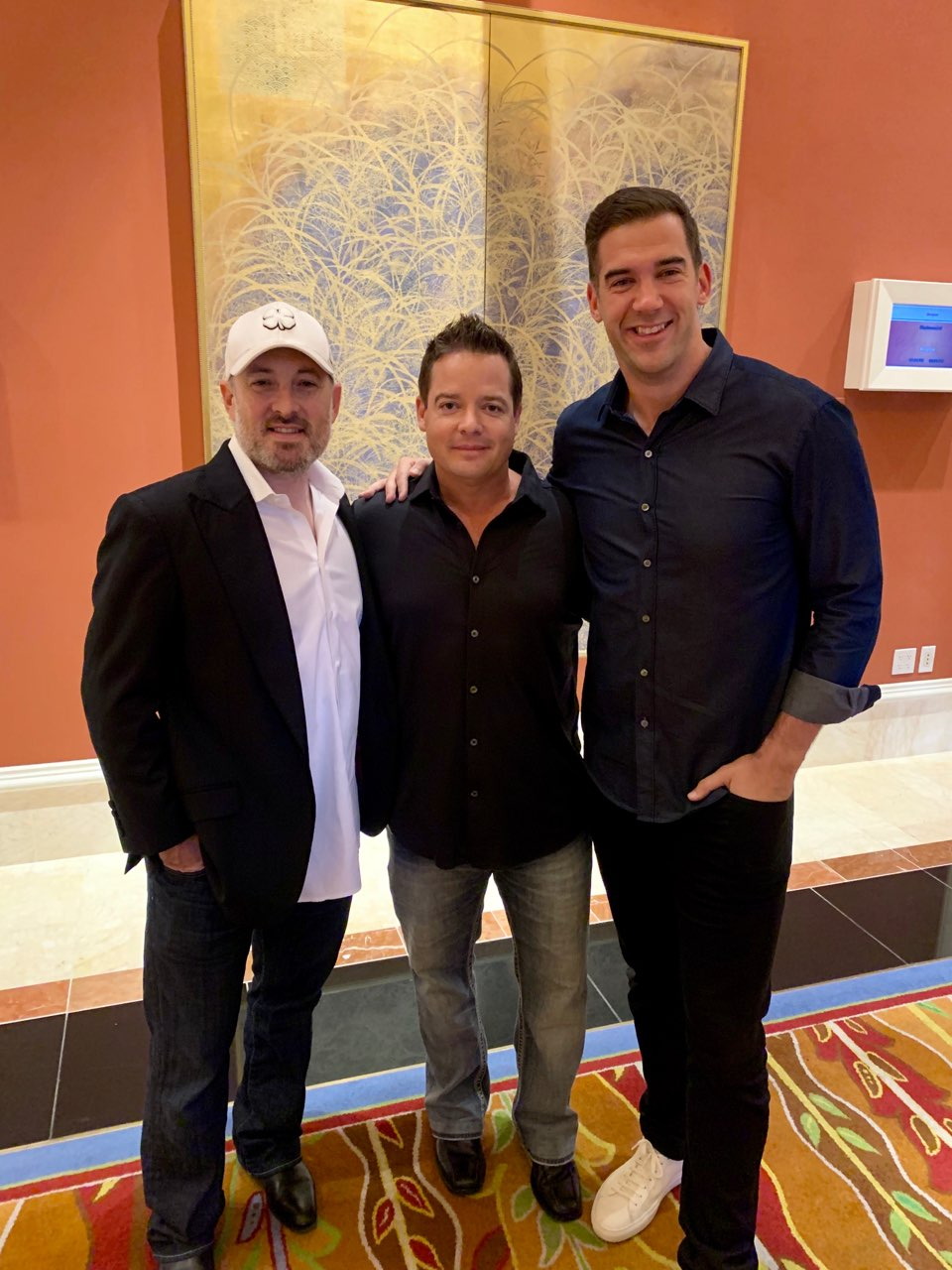 Josh Bezoni at a Las Vegas award ceremony with longtime friends Mike Dillard and Lewis Howes